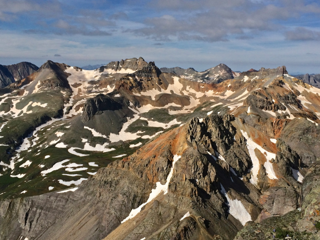 Looking at V4, Pilot Knob, Golden Horn, Vermillion, and Fuller from the summit of U.S. Grant Peak. Ice Lakes Basin.