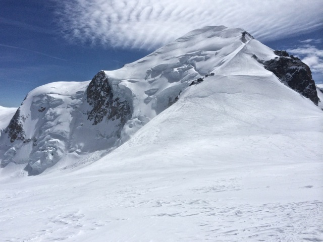 Finally, the summit of Mt Blanc! As seen from the Dome du Gouter. The Vallot Bivouac at ~14,500' can be seen on the other side of the broad expanse.